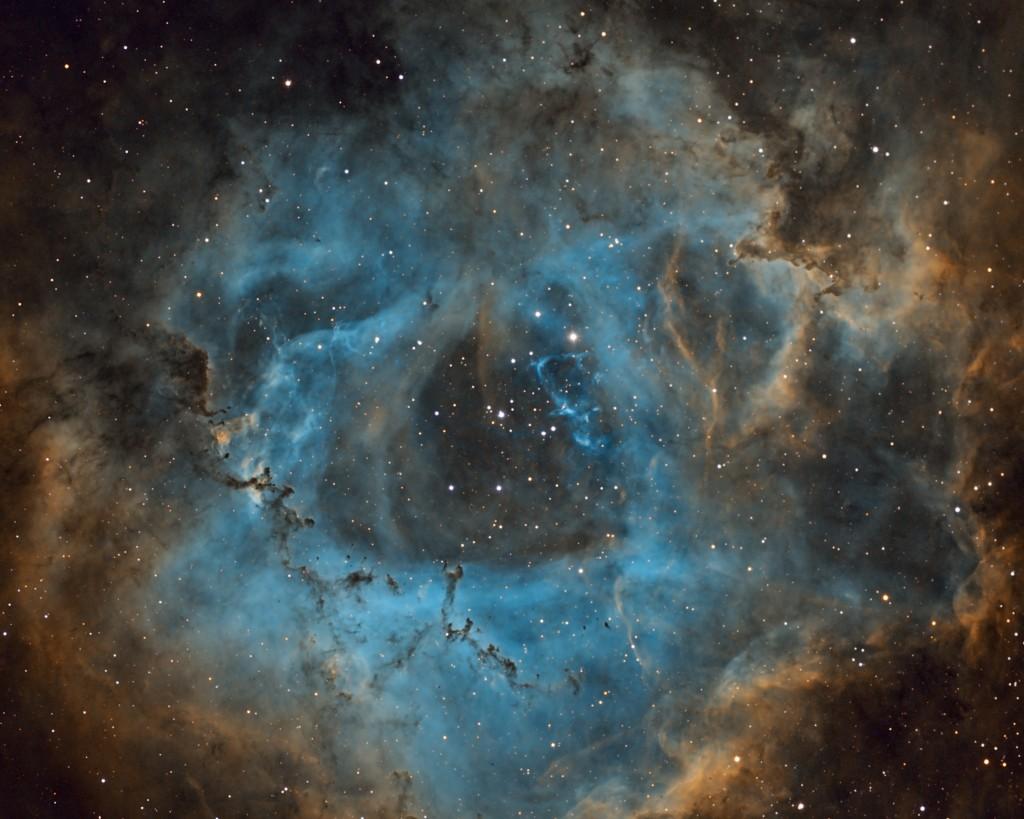 The Rosette Nebula:  Apogee U8300 CCD, Stellarvue SVQ100 APO, Atlas EQ-G, Astrodon 3nm Filters, 6x20min each Ha, O[III], S[II].